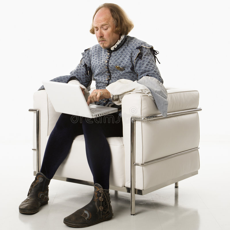 Shakespeare en la computadora portátil foto de archivo libre de regalías