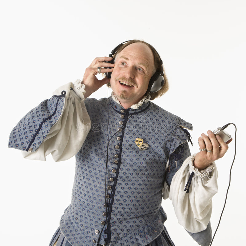 Shakespeare listening to music. William Shakespeare in period clothing listening to mp3 player smiling royalty free stock photos