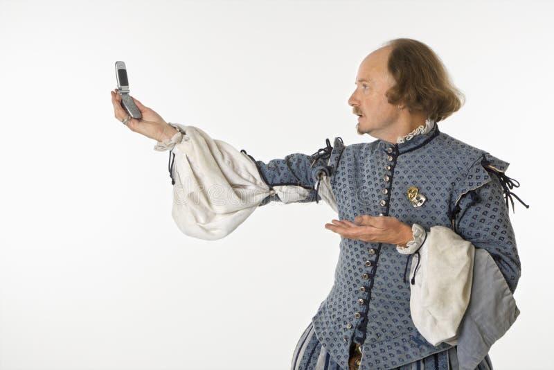 Shakespeare met celtelefoon. royalty-vrije stock foto