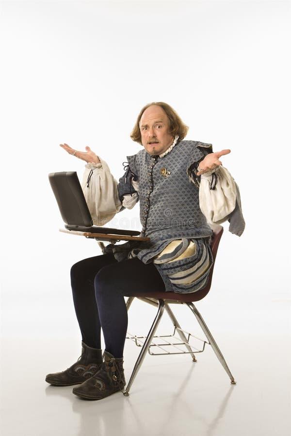 Shakespeare met laptop. royalty-vrije stock fotografie