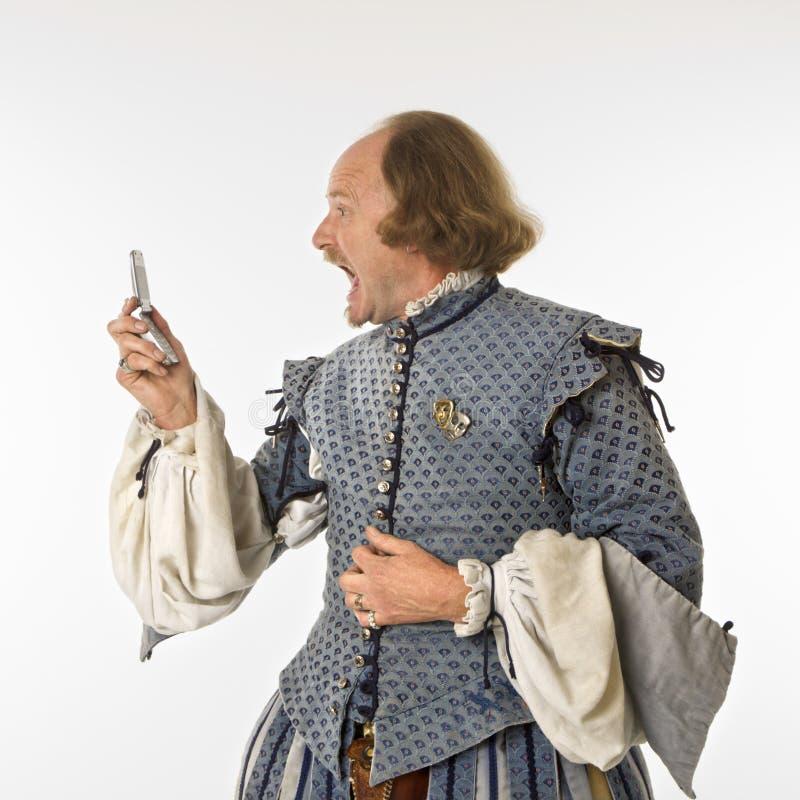 Shakespeare que grita en la célula imágenes de archivo libres de regalías