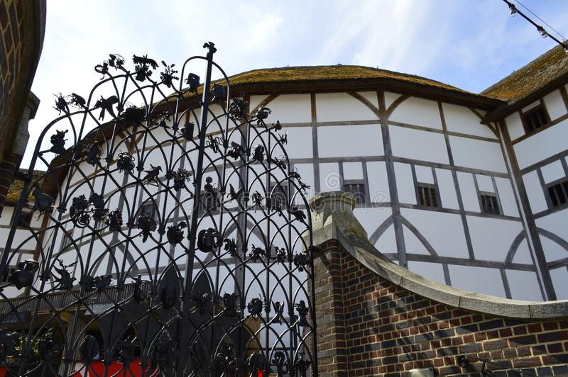 Ornate Iron Entrance Gate to The Globe Theatre on Londons South Bank. Shakespeares`s globe theatre and beautiful iron gated entrance,the globe is situated on stock photos