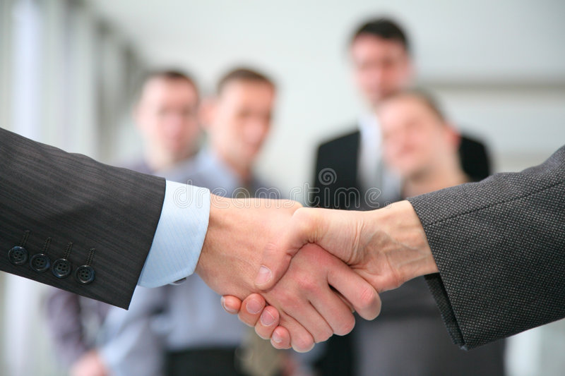 Shaking hands. And business team