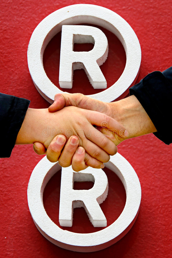 Shaking hands. Registered trademark symbol in background royalty free stock image