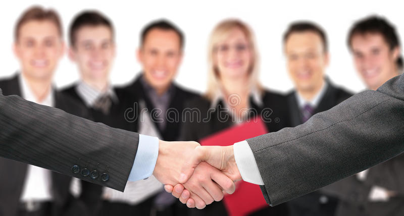 Download Shaking Hands And Business Group Out Of Focus Stock Image - Image: 12262785