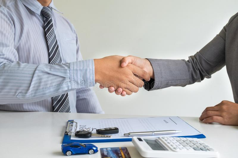 Shaking hands, Car dealership provides advice about insurance details and car rental information and delivers the keys. After signing the rental contract royalty free stock image