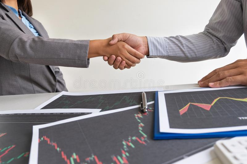 Shaking hands, A team of business executives are planning consultations about business investments related to shares. By analyzing and calculating the stock royalty free stock image
