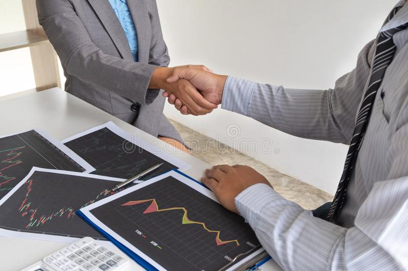 Shaking hands, A team of business executives are planning consultations about business investments related to shares. By analyzing and calculating the stock royalty free stock photos