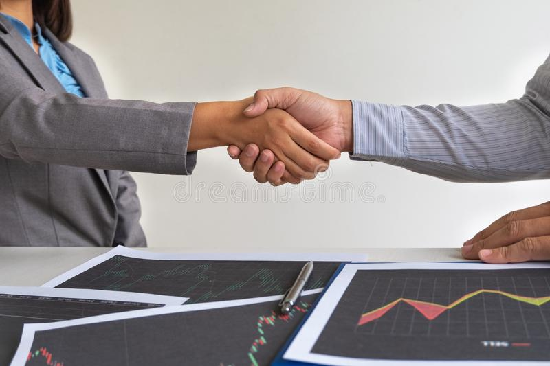Shaking hands, A team of business executives are planning consultations about business investments related to shares. By analyzing and calculating the stock stock photo