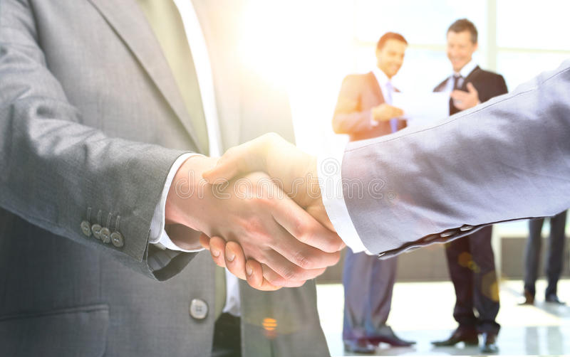 Shaking hands to confirm their partnership. Close-up of business people shaking hands to confirm their partnership royalty free stock photo