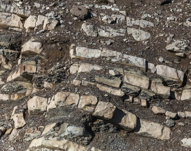Shale mountains cement pits. The texture of the stone wall. Large stone cracks, the separation of the stone ridge. Background of royalty free stock photography