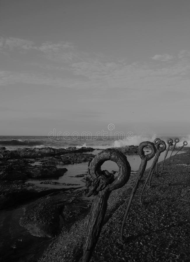 We shall not vanish from the surface of the earth. Rusty setting which will never be swallowed by the crashing waves stock photos