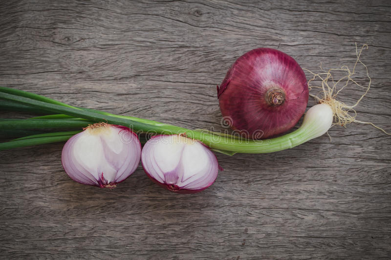 Shallot with garlic plant on old wood texture table. Shallot with garlic plant on old wood texture table, herbal of Thai food ingredient concept with copy space royalty free stock photography