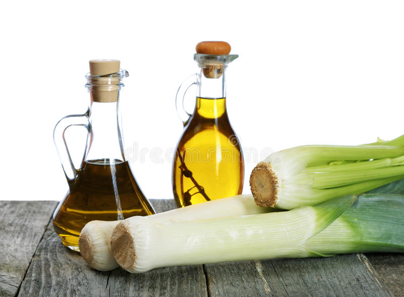 Shallots and bottles of olive oil on table royalty free stock photography