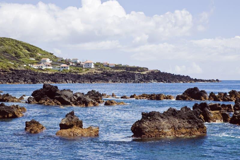 Shallow coastline of Pico island, Azores. Rocky volcanic shallow coastline, Pico island, Azores, Portugal royalty free stock photo