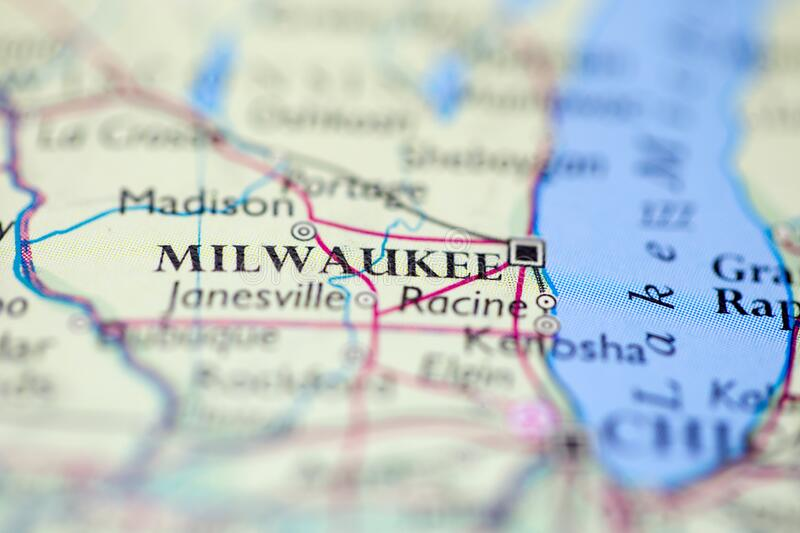 Shallow depth of field focus on geographical map location of Milwaukee city United States of America USA continent on atlas.  stock image