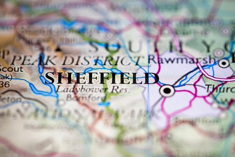 Shallow depth of field focus on geographical map location of Sheffield city England United Kingdom Great Britain Europe continent. On atlas royalty free stock photo