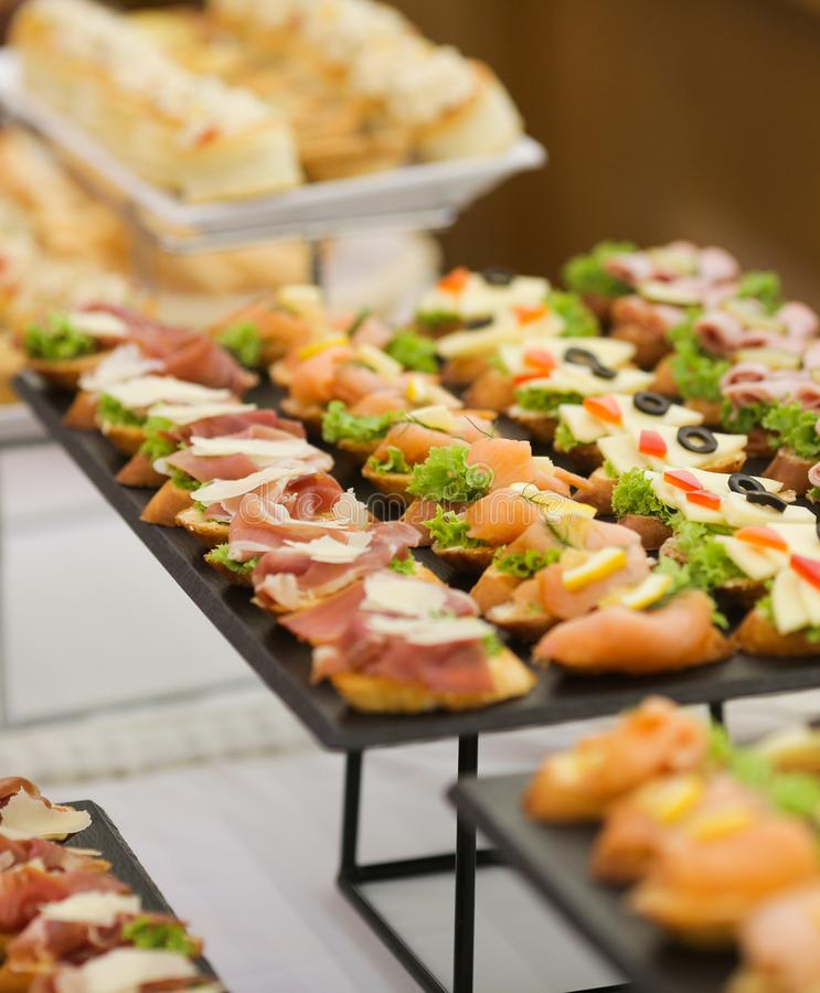 Shallow depth of field image with appetizers on a table at an event, provided by a catering company stock photography
