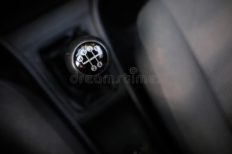 Shallow depth of field image with an old and broken gear shift knob of a manual gearbox car stock images