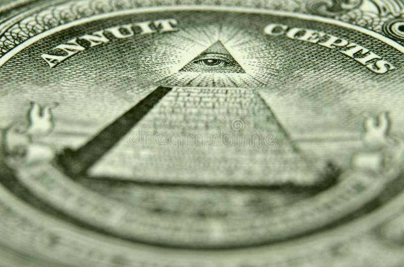Shallow depth of field picture of the eye of providence on the back of an American single. Shallow depth of field shot of the Eye of Providence, from the US royalty free stock image