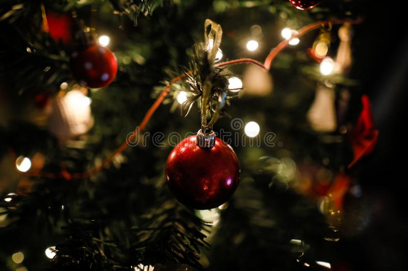 Shallow depth of field selective focus image with decorations on an artificial christmas tree.  royalty free stock image