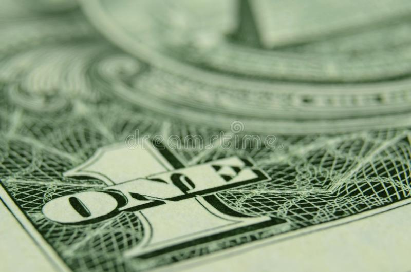 Shallow focus on ONE from the American dollar bill. royalty free stock photo