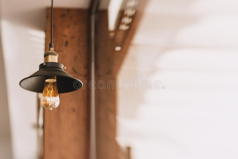 Shallow Focus Photography of Black and Orange Pendant Lamp stock image
