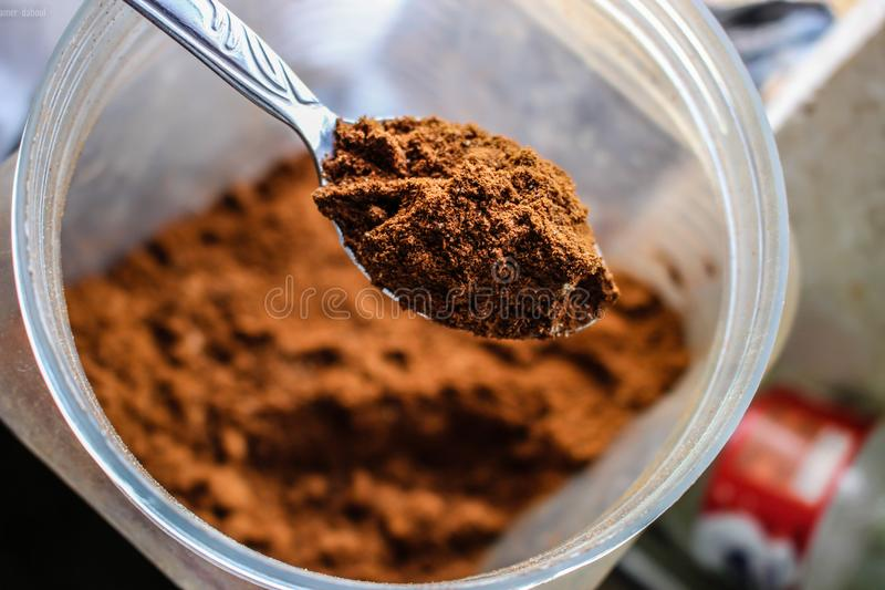 Shallow Focus Photography of Brown Powder on Stainless Steel Tea Spoon stock photo