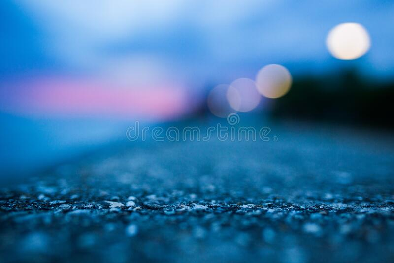 Shallow Focus Photography of Gray Asphalt Floor stock photo
