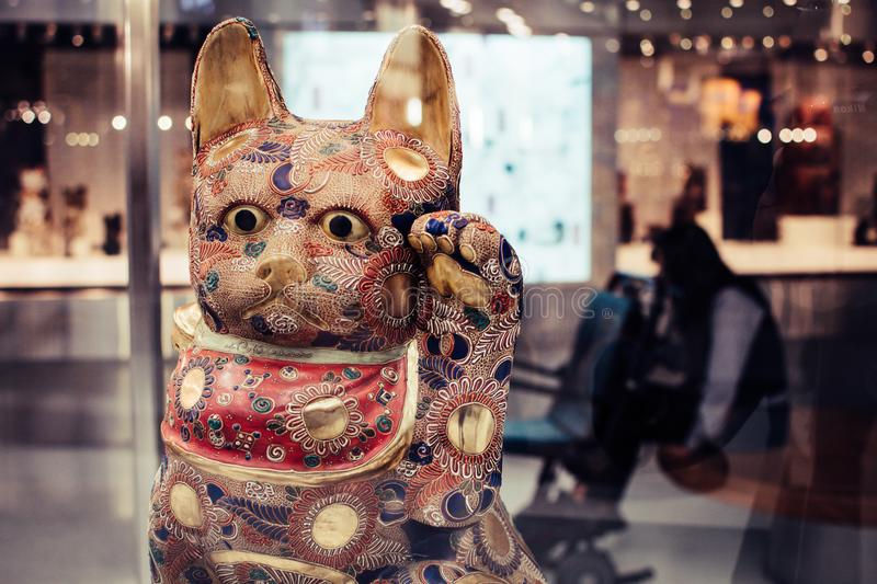 Shallow Focus Photography of Maneki-neko Figurine royalty free stock photo