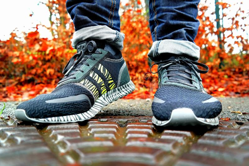 Shallow Focus Photography of Pair of Black Black-and-white Adidas Running Shoes royalty free stock photos