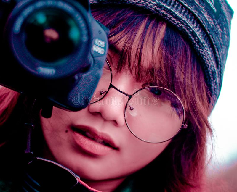Shallow Focus Photography of Woman Taking a Photo Using Canon Eos 600d Dslr Camera stock image