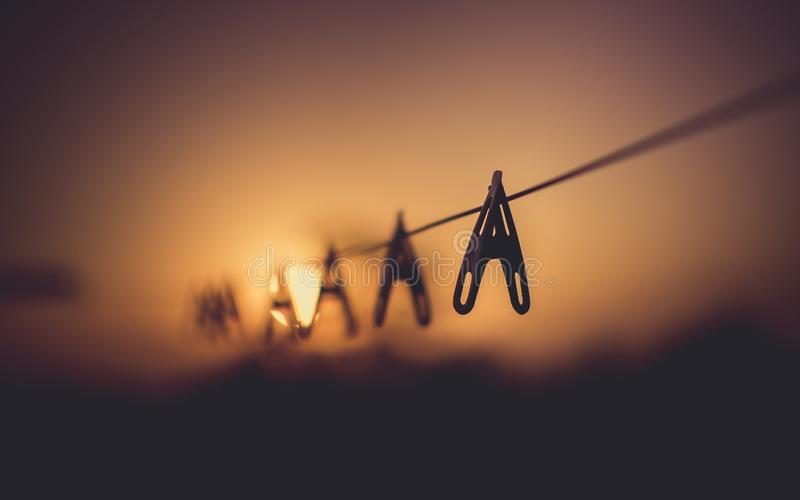 Shallow Focus Photography of Wooden Clothes Clip on Clothes String Rack royalty free stock photos