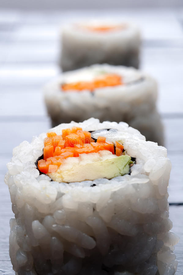 Free Shallow Focus Vertical Macro Of 3 Rolls Of Sushi Royalty Free Stock Image - 9833946