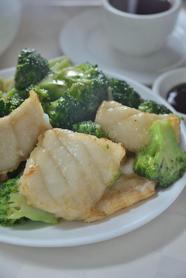 Fried grouper broccoli royalty free stock photography
