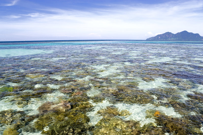 Shallow Open Sea and Island. Image of the shallow open sea in Malaysian waters with an island in the background royalty free stock photography