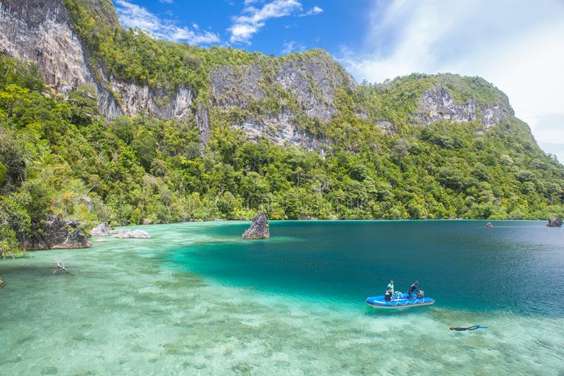 Shallow Reef and Limestone Islands in Raja Ampat. A shallow and healthy reef flat fringes the rugged limestone islands of Raja Ampat, Indonesia. This tropical stock photos