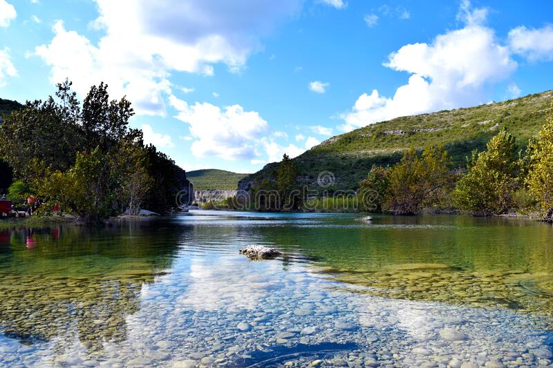 Shallow river in lush landscape royalty free stock images
