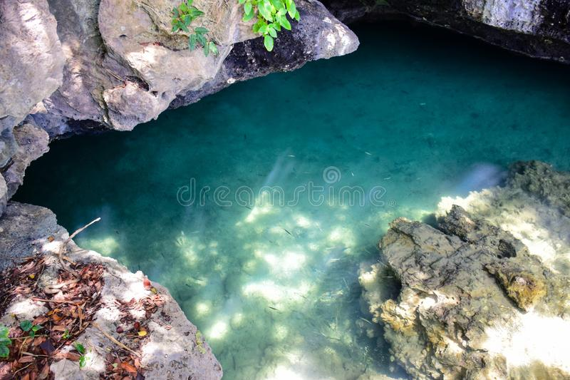 Shallow sea water surface shines through the bottom with stone and rock stock photo