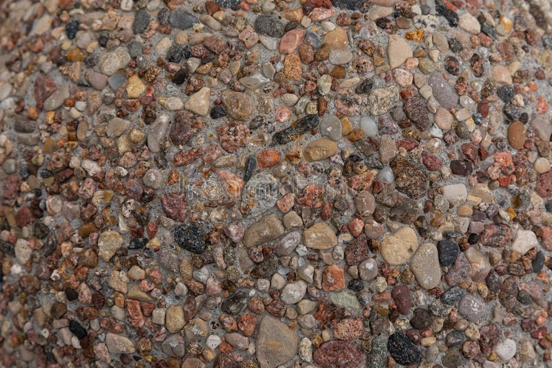 Shallow stones and pebbles texture on ground. Nature pattern of sandy colours. Shallow stones and pebbles texture on ground. Nature pattern of sandy colours stock images