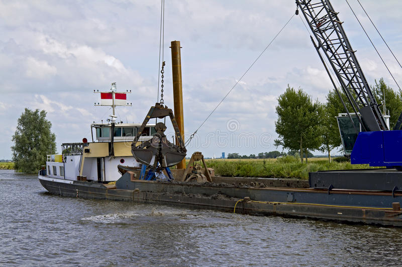 Shallow Water Dredging Royalty Free Stock Images