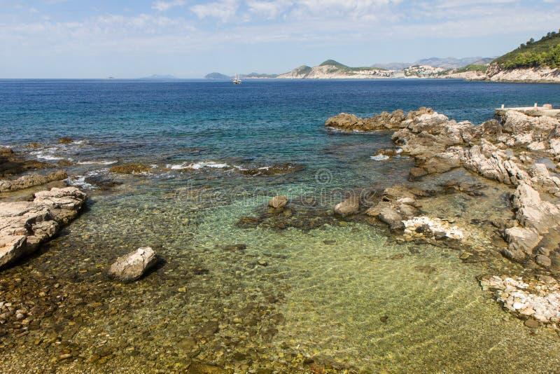 Shallow water and rocky coastline at Lokrum Island stock photo