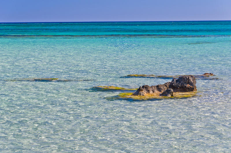 Shallow waters of Elafonisi beach, island of Crete. Amazing beauty of crystal clear waters at Elafonisi beach, island of Crete, Greece stock photography