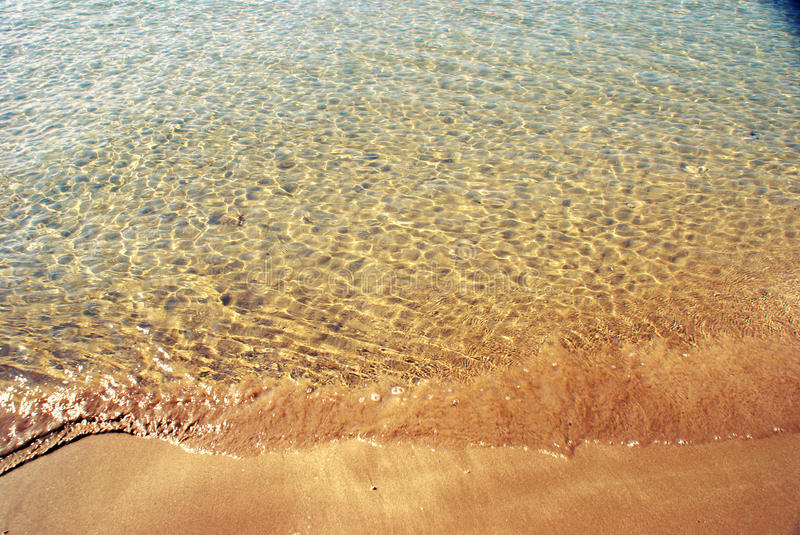 Shallow waters. The inviting clear waters on the shore royalty free stock images
