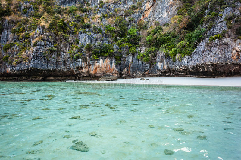 Shallow waters. Maya Bay is sheltered by high cliffs on three sides with several beaches with soft white sand and exotic fish in clear water stock photography