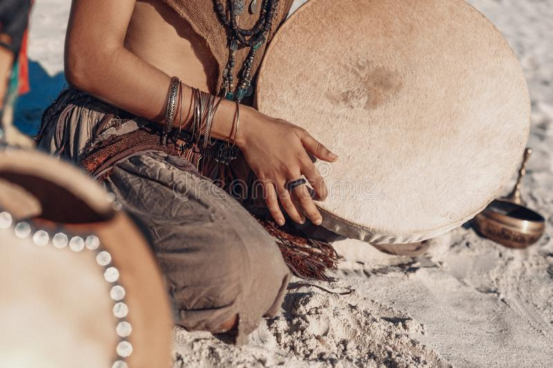 Shaman drum in woman hand. playing ethnic music stock images