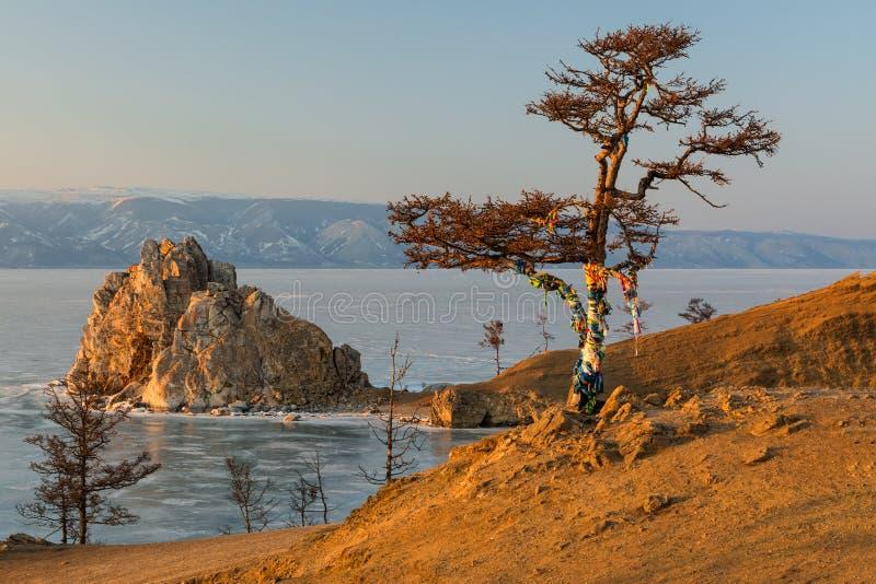 Shaman Rock on Lake Baikal during the winter setting sun royalty free stock image