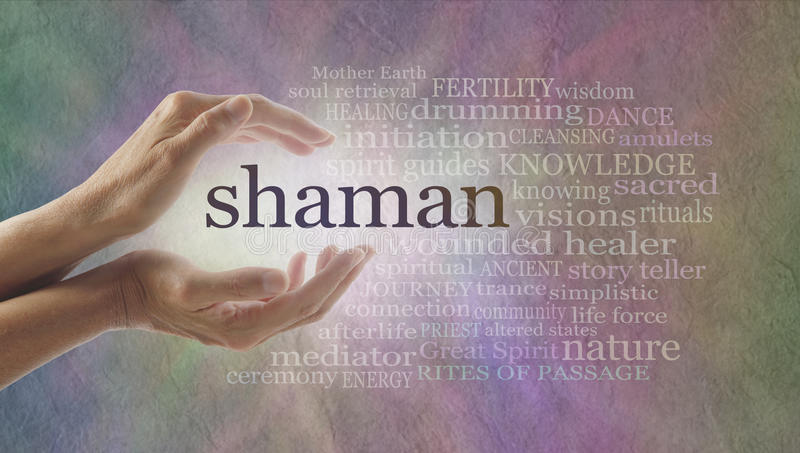 Shaman word cloud and healing hands. Female cupped hands with the word SHAMAN between lit by white light surrounded by a word cloud on a pastel colored stone royalty free stock photo