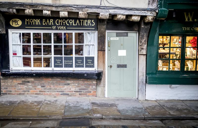 The Shambles, York 16th February 2018. Monk bar chocolatier of York quaint shop on the historic Shambles in York. UK royalty free stock photos