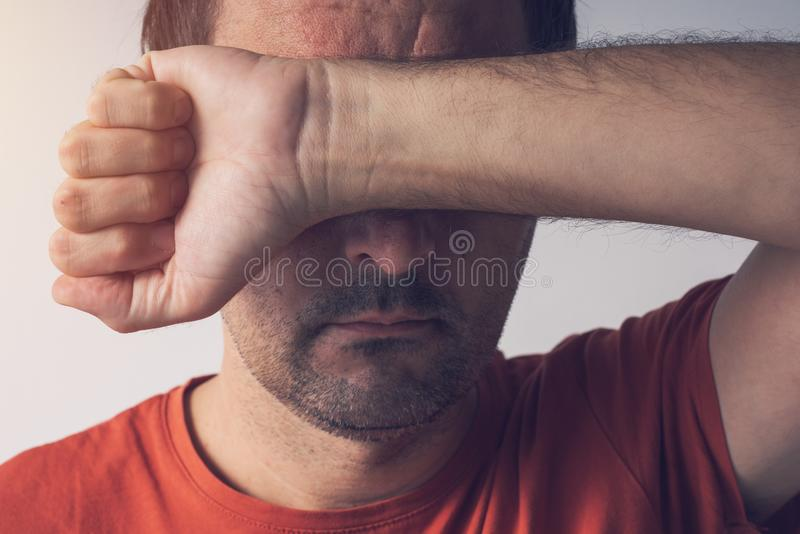 Shame and guilt, man covering face. Ashamed disgraced and embarrassed person royalty free stock photo